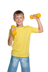 Cheerful boy with dumbbells