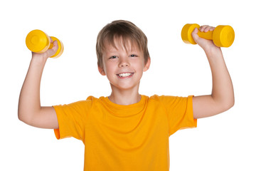 Cheerful boy with dumbbells do exercises