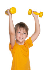 Cheerful boy do exercises with dumbbells