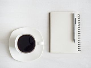 Coffee with book and Pen on White Table Background