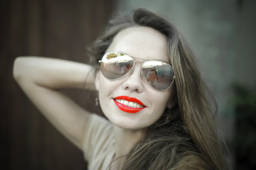 Monochrome portrait of young beautiful woman with red lipstick