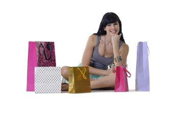 Young attractive girl sitting with shopping purchases