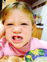Mischievous gap-toothed girl