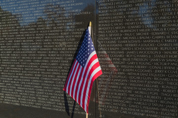 US Flag in front of Vietnam Veteran's Memorial Wall