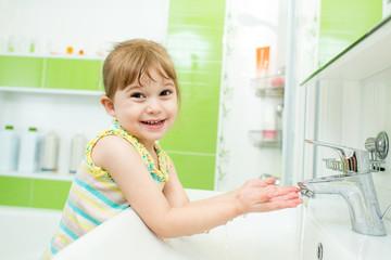 kid girl washing in bathroom