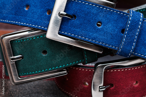 Close-up view of three suede belts - 72588504