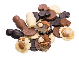 Assortment of tasty chocolates, isolated on white