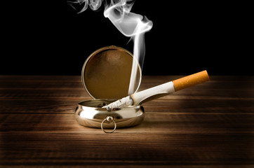 ash-tray with a cigarette