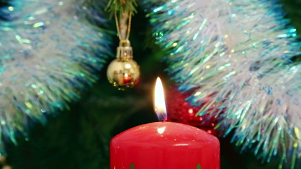 Christmas decorations and candle