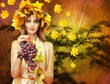 Beautiful young woman with yellow autumn wreath outdoors