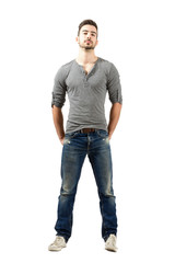 Fit young man in jeans and v-neck shirt