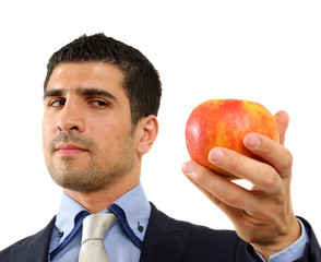 Young person holding an apple in his hand