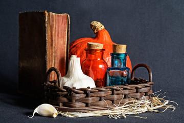 Garlic, vintage book and medical glasses