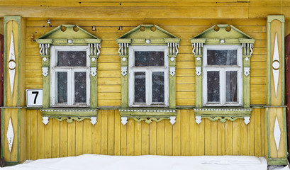 Russia. Suzdal. Three windows with carved wooden frames.