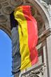 Belgian flag waving in Triumphal Arch in Cinquantenaire Park