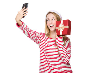 Woman with santa hat and take selfie with gift box