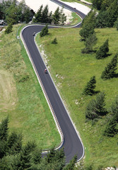 bikers along the way with many curves in the mountains