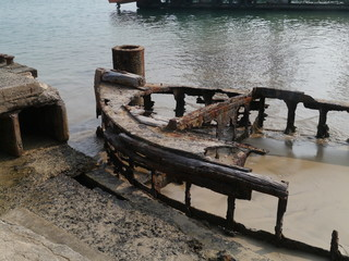 The carcass of a  iron vessel anchored in a river