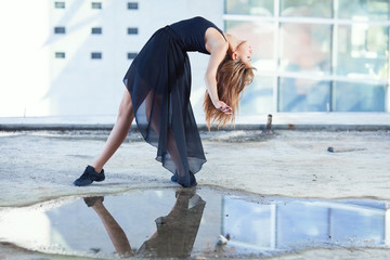 Beautiful young dancer in a sensual pose