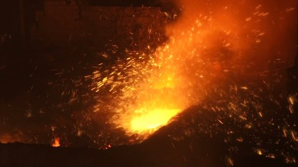 Sparks of molten metal
