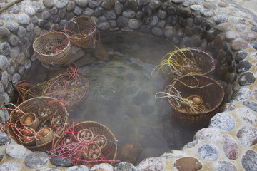 Eggs boiled in mineral spring basin, Thailand