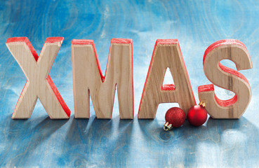 decorative wooden letters xmas on a blue background