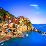 Manarola village, rocks and sea at sunset. Cinque Terre, Italy - 72599340