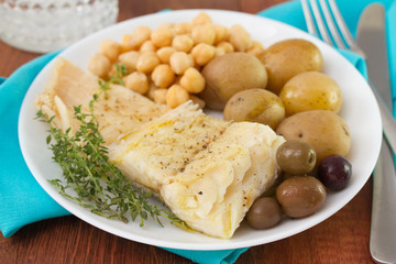 fish with potato and chick-pea on plate