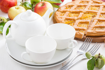 White crockery for the tea party and apple pie