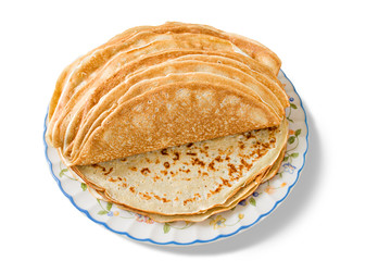 a pile of freshly cooked pancakes on a plate, isolated