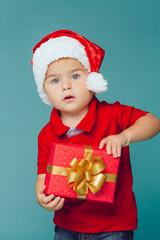 Boy in Santa red hat