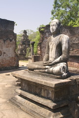 Beautiful statue of Buddha in ancient hinduist temple