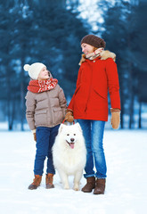Christmas, winter and people concept - beautiful happy family