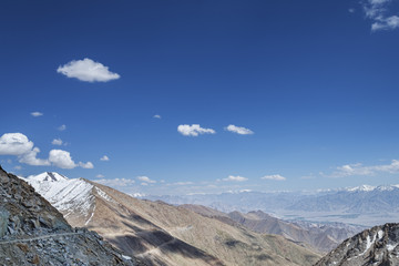 Aerial view to mountain range and valley of Leh