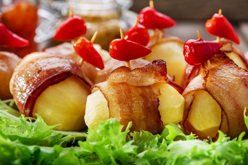 potatoes wrapped in bacon and baked