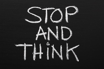 The phrase Stop and Think written on a blackboard