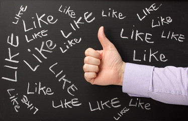Social Media concept with a Thumbs up for Likes