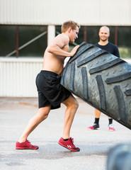 Sportsman Flipping Truck Tire