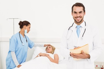 Doctor with colleague and patient behind