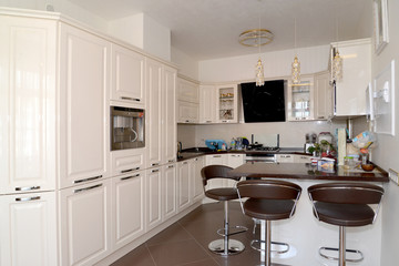 Interior of a kitchen-dining room in light tones