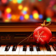Christmas ball on piano keys