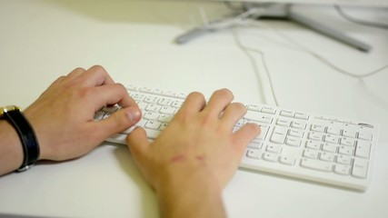 man works on computer - office - man typing on keyboard