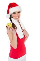 Festive fit brunette holding apple