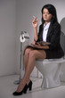 girl sits in toilet and smoking cigarette.