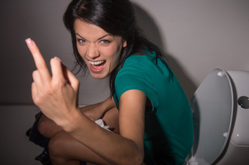 Portrait of young woman shouting in toilet to camera