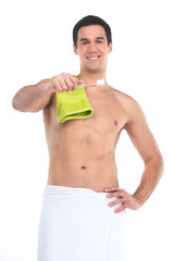 Close up of sexy fit man in towel holding