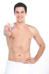 Young handsome men holding deodorant for armpits.