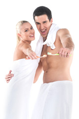 Close up of sexy fit man and woman in towel holding