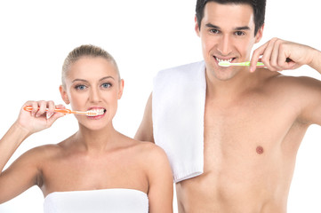 Close up of sexy fit man and woman brushing teeth