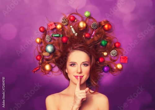 Leinwanddruck Bild Beautiful redhead girl with christmas toys and canes in hair on